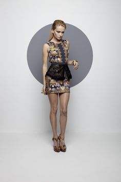 Maurie and Eve Macaw Dress W Mesh Peplum find it and other fashion trends. Online shopping for Maurie and Eve clothing. Sleeveless mini dress with high...