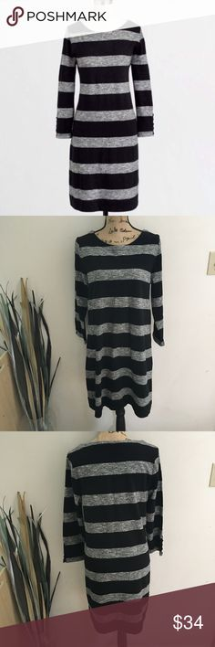 J. Crew rugby stripe dress This is a great fall into winter dress from J Crew. Black and marled gray stripes, cute button detail on sleeves. Like a cross between a sweatshirt and sweater material. Sz medium. Excellent condition. J. Crew Dresses