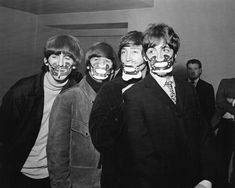 Manchester, December 7 - The Beatles wear face masks as a precaution against the fog.