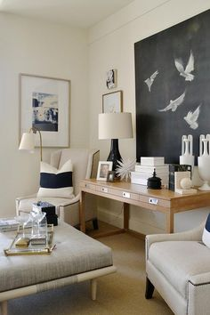 Chic living room features a 4 drawer console table under a black and white canvas art piece flanked by ivory nailhead wingback chairs lined with white and navy stripe pillows. Chic Living Room, Living Room Art, Home And Living, Living Room Designs, Home Decoracion, Interior Desing, Decoration Inspiration, Decor Ideas, Design Inspiration