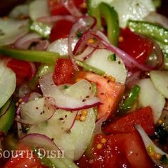 Fire and Ice Summer Salad Recipe with apple cider vinegar, red wine vinegar, sugar, salt, horseradish, celery seed, mustard seeds, green bell pepper, purple onion, jalapeno chilies, tomatoes, cucumber