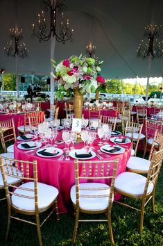 Love the black chandeliers and hot pink table cloths.  I would just choose different flowers for centerpieces, but gorgeous.  The colors I plan to have: hot pink and black :)