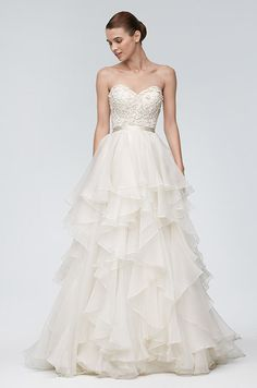 The Watters bridal dresses continued to evolve in sophisticated ways. Their beaded, embroidered corsets, voluminous ball gown skirts, flattering silhouettes, colored wedding dresses, and lace wedding dresses live up to every girl's wedding dreams.