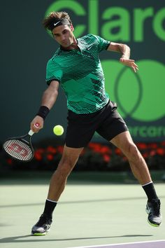 Roger Federer Photos Photos - Roger Federer of Switzerland in action against Tomas Berdych of Czech Republic at Crandon Park Tennis Center on March 30, 2017 in Key Biscayne, Florida. - 2017 Miami Open - Day 11