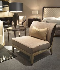 New Kos armchair with Ebony veneer back, Rubelli Almoro Spago fabric upholstered and piped in Donghia Sabrina Bronze, frame and legs covered in leather with black nickel caps