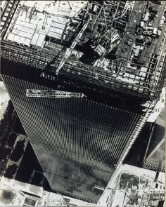 Aerial view of Twin Towers of World Trade Center under construction, looking east, September 1971