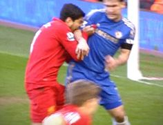 Luis Suarez (Liverpool) bites Ivanovic (Chelsea) in a Premier League game (April, 2013)