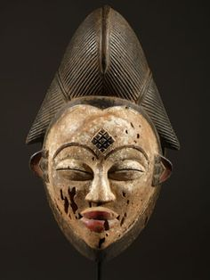 The African mask Punu or worship of the dead in Africa