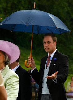 Britain's Prince William checking out the rain as he leaves following the wedding of Thomas van Straubenzee and Melissa Percy at St Michael's Church in Alnwick, northern England 22 June 2013