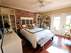 exposed brick wall and hardwood floors in bedroom - love!