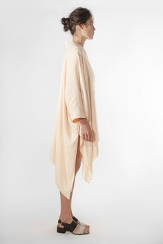 The EINE Caftan Dress is a loose and versatile item. It is made from a high quality Italian silk-viscose, which gives the garment a flowing look and a warm touch. The decorative topstitch on the collar and cuffs adds subtle, elegant detail. The garment can be worn on its own as a dress, or as a top. #einestudios #eineltd #caftandress #caftan #cream #womensfashion #loungewear #luxury #ladieswear #lounging #dress #highend #highendfashion