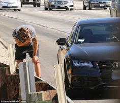 Well that's embarrassing: Harry Styles had to pull over his car to the side of the road in Los Angeles on Saturday to throw up awe my poor baby he got sick from hiking