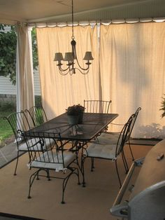 DIY curtains with pvc pipe, drop cloth, and shower curtain rings. great for the patio and durable with rough weather