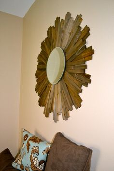 My DIY Sunburst Mirror  I used wood shims from home depot