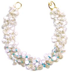 Helga Wagner Mother Coin Fresh Water Pearls with turquoise chips.
