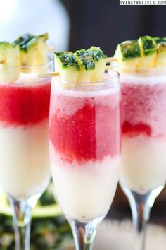 """Strawberry """"Lava Flow"""" Pina Colada - Creamy, sweet coconut cream pineapple banana Pina Colada with strawberry coconut rum poured into the bottom of the glass. This cocktail is named """"Lava Flow"""" because the strawberry rum rises to the top of the coconut cream, leaving a lava like appearance. #ThePerfectMix #sponsored"""
