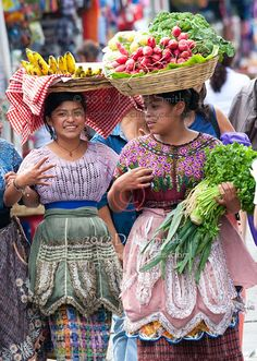 Colorful close-up portraits of ethnic Mayan women wearing local costume in Antigua, Guatemala, Central America