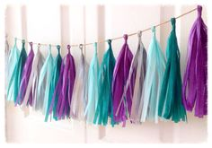 Frozen Themed TWIZZLES Tissue Paper Tassel Garland!    This Adorable Paper Hanging Tissue Paper Tassle Garland is the Perfect Personal Touch for