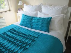 Pintucked turquoise duvet cover.