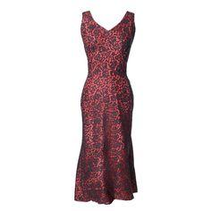 1950s Vintage Emma Domb Dress Red Black Lace Fish Tail Hem    See more vintage Evening Dresses at https://www.1stdibs.com/fashion/clothing/evening-dresses/evening-dresses in 1stdibs