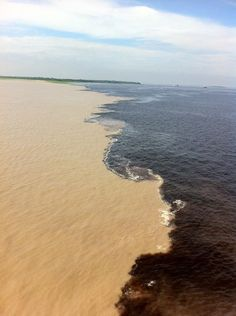 """Meeting of the Waters"" is the point at which the Rio Negro meets the Rio Solimões in the Brazilian state of Amazonas - Manaus City. Due to differences in temperature, speed and density, the two rivers' differently colored waters don't mix immediately, but flow side by side for several miles."