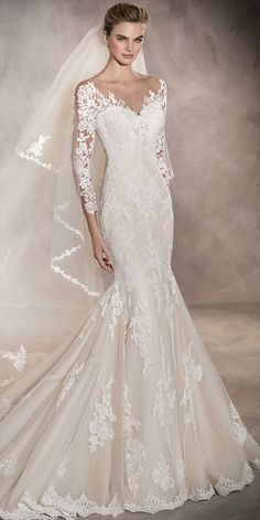 Spectacular mermaid wedding dress that flares out at the bottom. It has 3/4 sleeves with gorgeous floral lace and guipure motifs all over the body of this romantic dress. Simply marvelous!