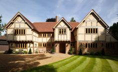 Border Oak Manor House with traditional exposed oak framing and porch with brick infill. Old Style House, Border Oak, Oak Frame House, Revival Architecture, Tudor Style Homes, Tudor House, Brick And Mortar, Timber House, Interesting Buildings