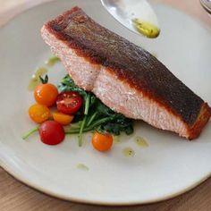 Recipes | Crispy Salmon on Lemon-Caper Wilted Greens | Sur La Table