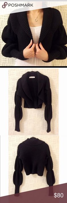 Trina Turk sweater size S/M Black thicker knit puffy sleeve sweater jacket.  Very flattering/slimming, great quality.  This is a re-posh.  Never got around to wearing it and now I am downsizing my closet.  Care tag is missing but it is a S/M.  No lowball offers please. Trina Turk Sweaters Cardigans