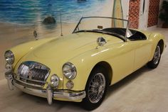 1961 MG MGA (mine was a 1962 and a little lighter yellow, but she was sweet and I miss her. )