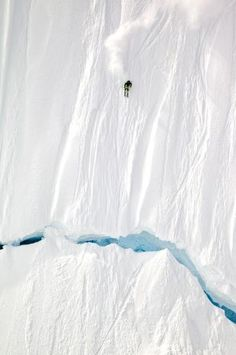 """©Mark Fisher """"We spent half our month-long trip sitting in a hotel in Juneau, Alaska, waiting for the storms to break,"""" says Fisher, 35, of Victor, Idaho. When good weather arrived, Fisher helicoptered into the Coast Range to capture skier Ian McIntosh on this line, which required a 20-foot jump over a crevasse. """"There was six feet of fresh snow, and the conditions were absolutely perfect,"""" Fisher says."""