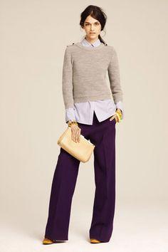 Dark purple trousers, light purple button down, light grey sweater. Yellow/gold clutch, jewelry, & shoes