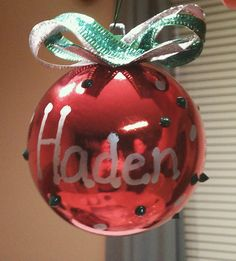 This is a homemade ornament I made for my son's class.  I made one for each student, they are really cute and easy.  All you need are the plastic Christmas balls from Wal-mart, hot glue, ribbon of your choice and a bottle of puffy paint and paint markers.  You take a ball, and create a bow of your choice and hot glue near the top, write the students name with a paint marker and take the puffy paint and make dots on the ball, and use the marker to make dots of another color also.  Hang the…