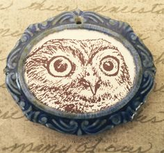 A personal favorite from my Etsy shop https://www.etsy.com/listing/245357235/owl-in-frame-pendant-owl-focal-porcelain