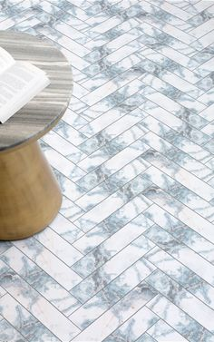 Azzurro is a Marble Effect Parquet Vinyl Flooring design that features a luxurious white and blue faux marble texture in a parquet, chevron style pattern. This unique flooring concept is perfect for adding an element of high-design and a beautiful marble look to your domestic or commercial space. #vinyl #flooring #inspiration #design #decor #home #homedecor #interior #interiordesign #Ihavethisthingwithfloors