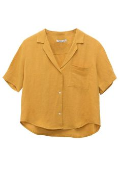 Light linen, mustard yellow, boxy cut, button down - this shirt has so many things going for it. Wear on sunny days, or on days where you wish there was more sun. Featuring a single breast pocket and a blazer-esque collar, this piece would look great buttoned up, or unbuttoned over a simple ta: