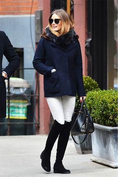 Olivia Palermo in Stuart Weitzman 5050 and wool, fur-lined jacket.
