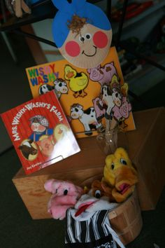 Mrs. Wishy Washy retelling corner (puppets, stick puppets, beanie babies, tub, soap, dress-ups, etc.)