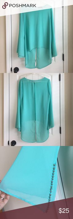 EUC Fabrik top EUC Fab'rik top. 100% polyester. Flowy with slit all the way down the back. Beaded detail on sleeves. Smoke free pet free home. Fabrik Tops