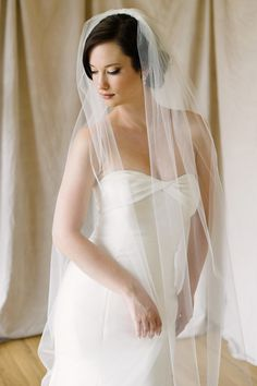 Sara Gabriel 'Lauren' veil | Hand-cut edge, slim silhouette classic veil. Sheer and sweep length.