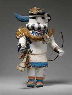 Long-Horned Katsina Long-Horned Katsina Date: late 19th century Geography: United States, Arizona Culture: Hopi Medium: Cottonwood, feathers, fur, shell, imitation pearls, bones, Native-tanned skin, pigment