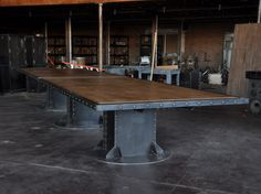 20' I Beam conference table with an aged maple top