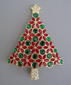 SWAROVSKI Annual Edition red, green and clear rhinestone set in gold tone Christmas tree brooch