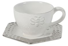 Bumble bee adorned cup and shimmery silver edge on octagon plate.  Lovely.