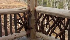 Vertical and Woven Branch Log Railing View rustic railing at http://awoodrailing.com