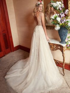 #RoseWater is a delicate and beautiful fully hand-embroidered ballgown with silver beads and a crystal stardust effect from the #FlorenceByNight collection. Don't you just love the semi-sheer bodice and low back?