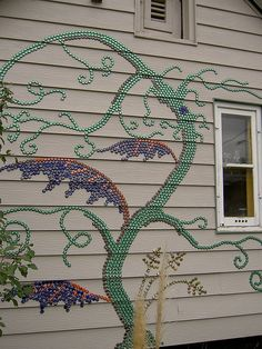 bottle cap mosaic - I love the idea of doing this on our back fence in the garden