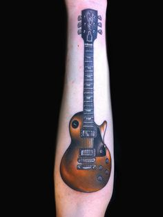 les paul guitar tattoo done by Jessi Lawson