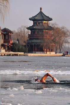 Ice River Swimming, Bejing, China  I could start to shiver violently just looking at this!!