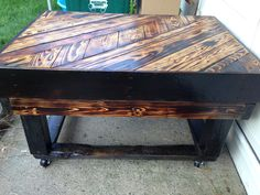 Outdoor pallet table. I burnt the wood, shou-sugi-ban inspired, then gave it an outdoor polyurethane.